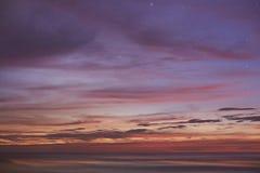 Orange sunset in ocean Stock Images