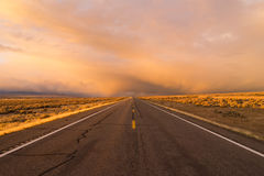 Orange Sunset Open Road Two Lane Highway Horizontal Royalty Free Stock Photo