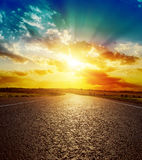 Orange sunset over asphalt road Stock Images