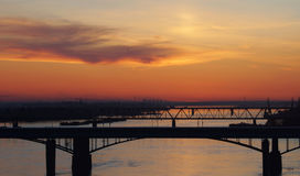 Orange sunset over bridges Royalty Free Stock Image