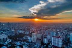 Orange sunset over the capital of Thailand. Evening shooting of Bangkok from a tall skyscraper Royalty Free Stock Photos