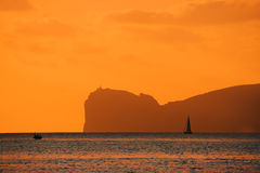 Orange sunset over Capo Caccia. Italy Stock Photo