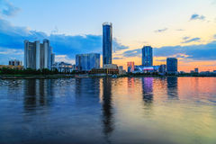 Orange sunset over the city pond and the business part of the city of Yekaterinburg Royalty Free Stock Image