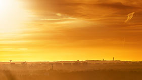 Orange sunset over a cityscape Stock Image