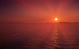 Orange sunset over dark sea. And islands. Adriatic coast, Croatia Royalty Free Stock Photography