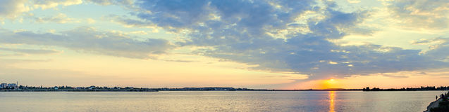 Orange sunset over a european lake, blue clouds sky Royalty Free Stock Photo
