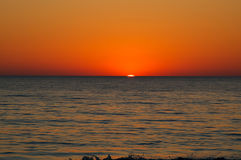 Orange sunset over horizon Royalty Free Stock Photography