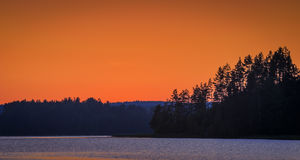 Orange sunset over lake Stock Photos