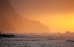 Orange sunset over Na Pali Stock Photography
