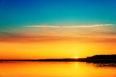 Orange sunset over river Royalty Free Stock Images