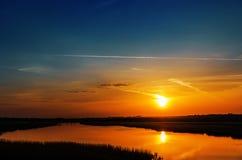 Orange sunset over river Royalty Free Stock Photo