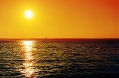 Orange sunset over river Stock Images