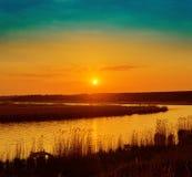 Orange sunset over river Royalty Free Stock Photos