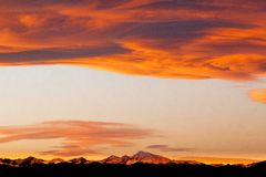 Orange Sunset over the Rocky Mountains. Gorgeous orange sunset over the Rocky Mountains in Parker, Colorado. The cloud colors in Colorado are amazing when the stock images