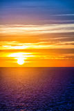 Orange sunset over sea water Stock Images