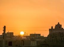 Orange sunset over village in iran Stock Photography