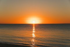 Free Orange Sunset Over Water Near The Beach. Stock Images - 156639424