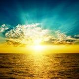Orange sunset over yellow sea Stock Images