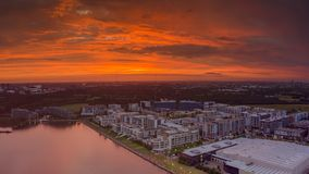 Orange sunset overlooking Wentworth Point in Sydney. Waterfront properties royalty free stock image