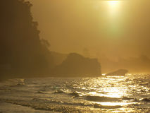 Orange sunset rocky coast. A golden glow sunset over a rocky coast Royalty Free Stock Photos