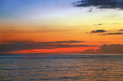 Orange sunset at sea. Sunset sky over the sea, the island of Langkawi Royalty Free Stock Photo