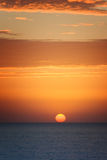 Orange sunset at the sea with sun Royalty Free Stock Image