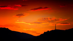 Orange sunset. Silhouetted mountains under an orange sunset sky Stock Images