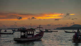 Orange sunset sky tourist boat beach port 4k time lapse thailand stock footage