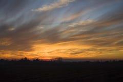 Orange sunset sky on a winter day. stock photos