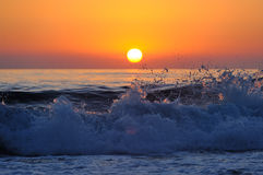 Orange sunset and surf. Turkey, Mediterranean sea Stock Images