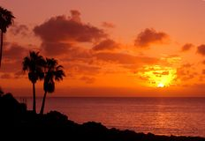 Orange sunset on tropical island Stock Photography