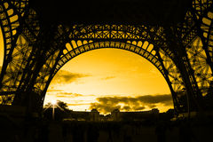 Orange sunset under Eiffel Tower royalty free stock image