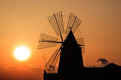 Orange sunset and windmill Royalty Free Stock Image