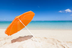Orange sunshade at the beach Royalty Free Stock Image