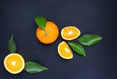 Orange sur un fond noir Images libres de droits