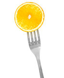 Orange sur une fourchette photo libre de droits