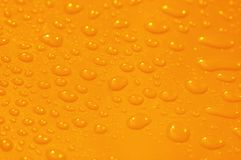 Orange surface. With water drops - shallow depth of field Royalty Free Stock Photography