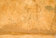 Orange surface wall soil crack Stock Photography