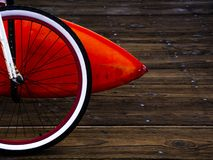 Orange surfboard and a bicycle parked on a pier stock photos