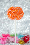 An orange sweet lollipop. Royalty Free Stock Photography