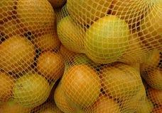 Orange, sweet orange or navel orange. The orange is a round juicy citrus fruit with a tough bright reddish-yellow rind stock photo