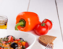 Orange sweet pepper and  cherry tomatoes Royalty Free Stock Photo