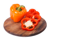 Orange sweet pepper and segments of red one Royalty Free Stock Photography