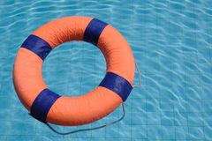 Orange swim ring floating on water Stock Photo