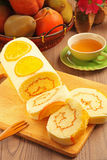 Orange swiss roll Stock Photos