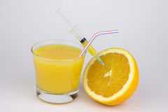 Orange with syringe Royalty Free Stock Image
