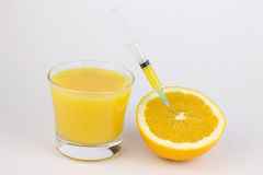 Orange with syringe Stock Image