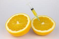 Orange with syringe Royalty Free Stock Images