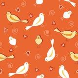 Orange Töne mit nahtlosem Muster der weißen Vögel Lizenzfreies Stockbild