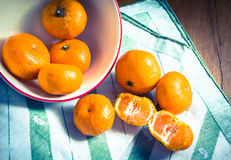 Orange on table cloth. Royalty Free Stock Photo